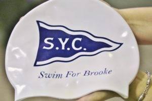Swim caps the team wore to honor Brooke, 2017 season.
