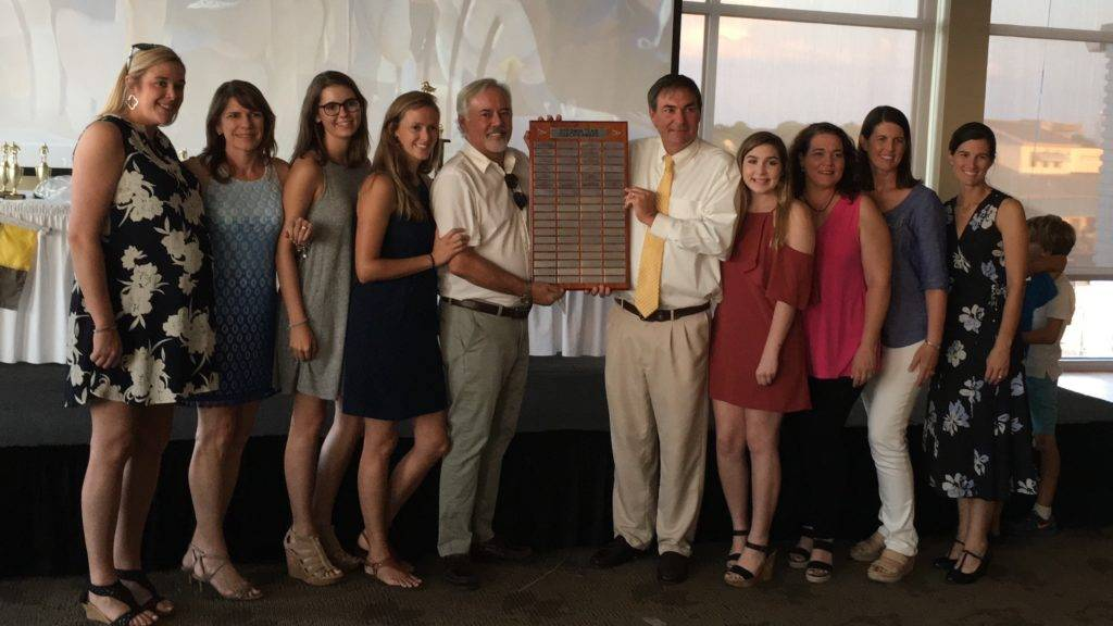 Danielle, Marie, Megan, Lauren, Ernest, Coach Bret, Lauryn, Melissa, Elizabeth and Brady with the Coach's award